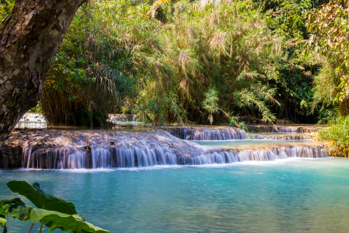 Kuang Xi Falls. Be there early to avoid the masses.