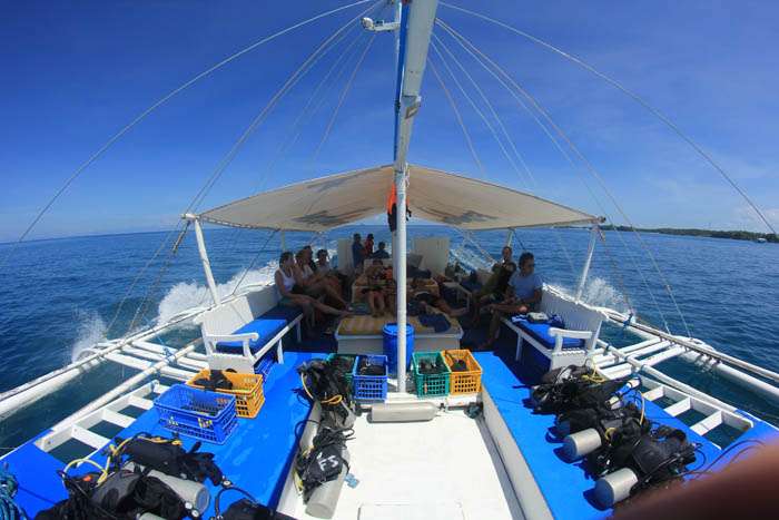 Getting shade on the dive boat.