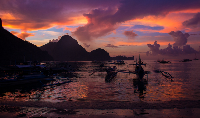 El Nido Bay by night. Armada of bankas anchoring.