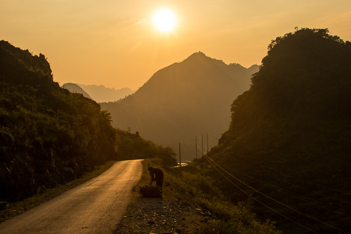 Sunset over Ha Giang Province and a lone Hmong woman